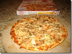 Dr. Oetker's Ristorante thin crust Funghi Pizza that was cooked on a pizza stone with the frozen pizza box in the background.