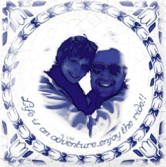 """A photo of the Dutch tile with the photo of Armando and myself with the words, """"Life is an adventure; enjoy the ride!!"""" that was featured on a KLM Royal Dutch Airline's Boeing 777-200 plane."""