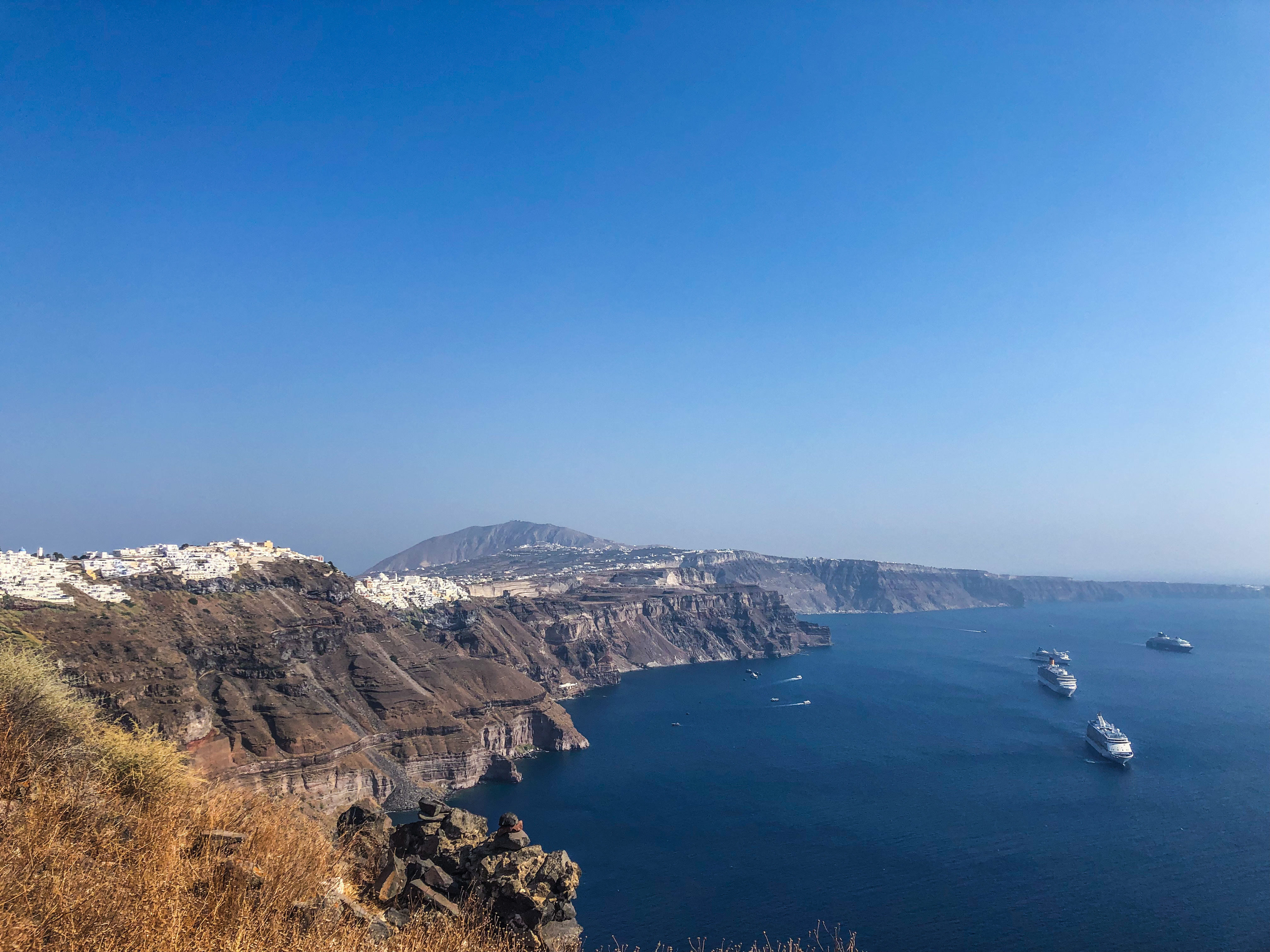 View of Fira in the distance and the cruise ships that will tender thousands of people onto the island for the day.
