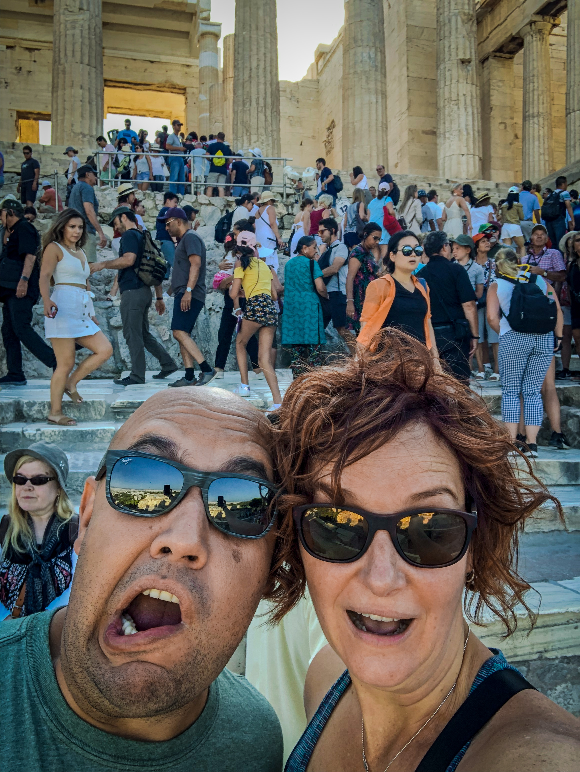 The Parthenon at the Acropolis in Athens, Greece at 9:12am with our shocked faces as the crowd gets even larger behind us.