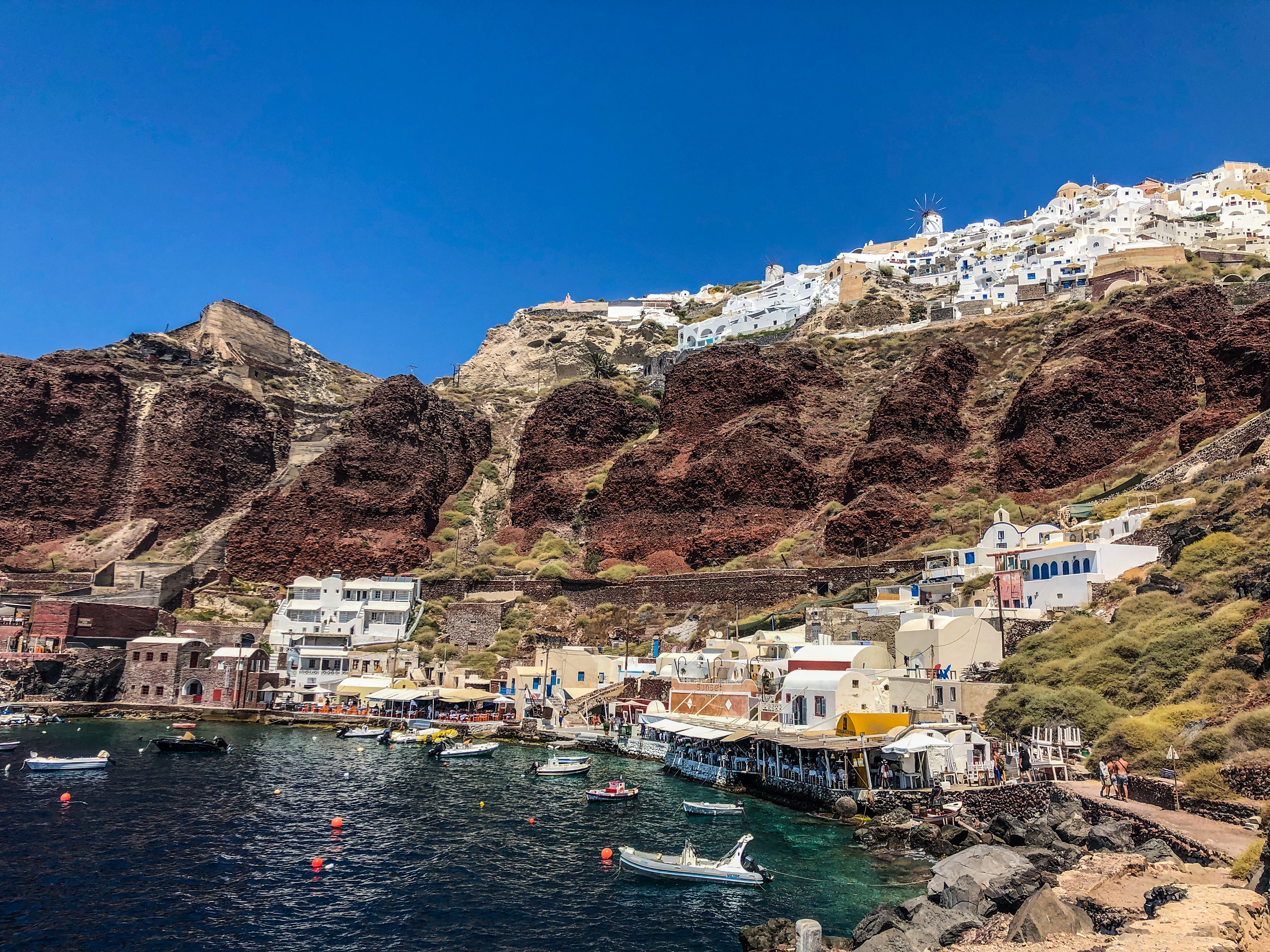Amoudi Bay, Santorini with the town of Oia at the top of the cliff.
