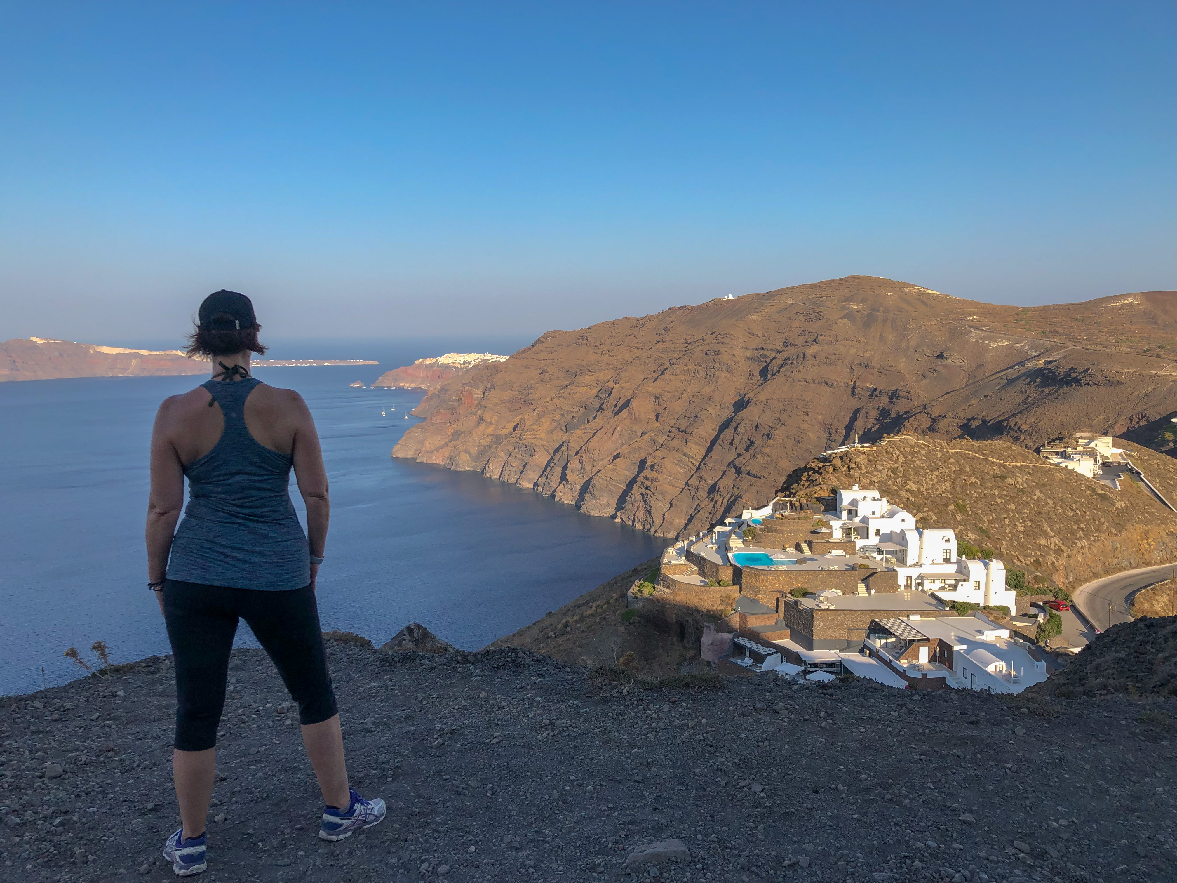 Standing in Imerovigli and staring at Oia in the distance, wondering if I can hike there before the heat sets in.