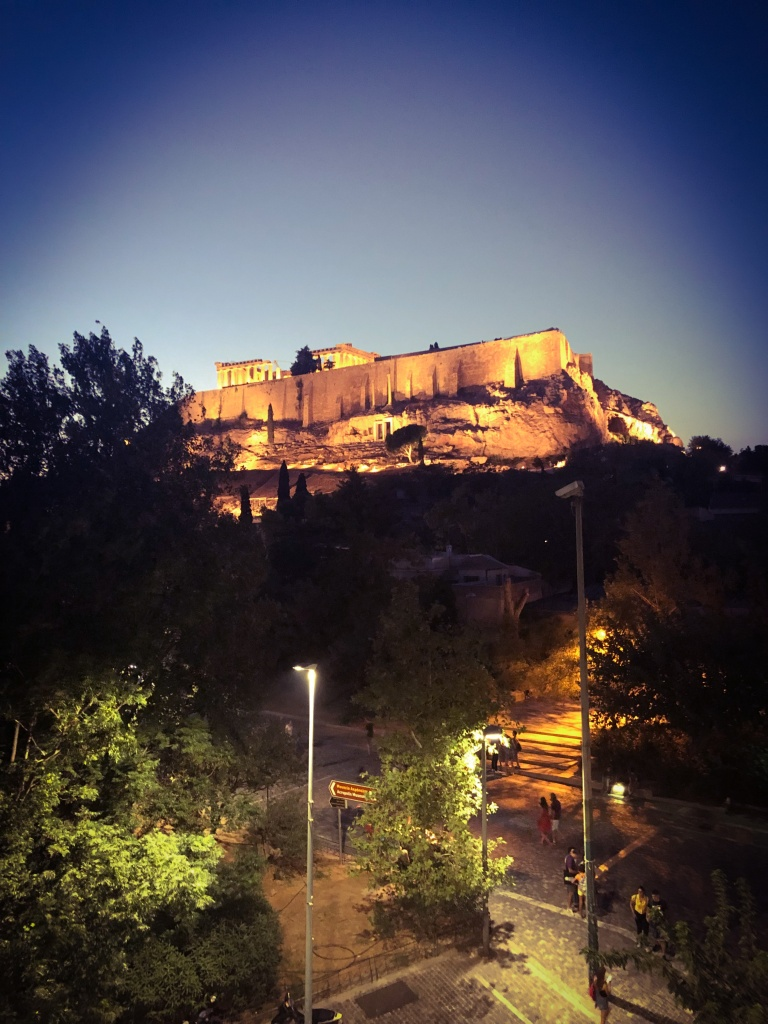 View of the Acropolis lit up at night from our Airbnb balcony.